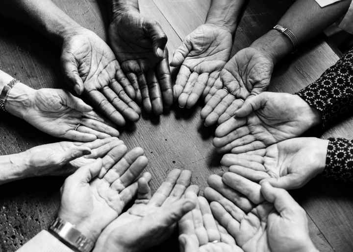 grayscale photography of people hand