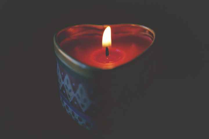close up of tea light candle against black background